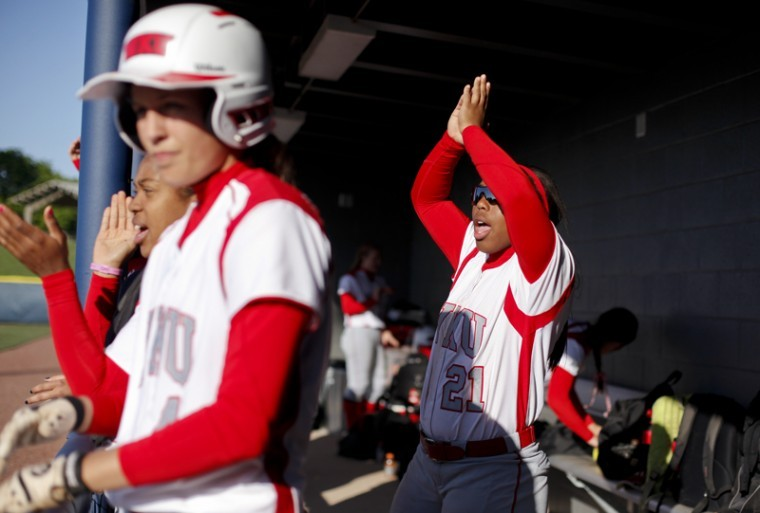 Sophomore+Kelsie+Mattox+cheers+while+a+Lady+Topper+is+at+bat+during+a+game+against+Belmont+at+E.S.+Rose+Park+in+Nashville+Wednesday.+WKU+defeated+Belmont%2C+3-0.%0A