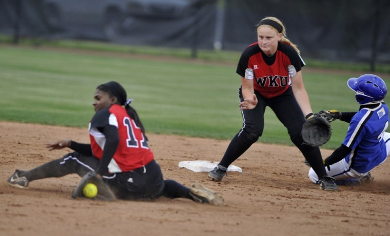 Sophomore infielder Olivia Watkins slides for the ball trying to get a Middle Tennessee State runner out at second base. WKU lost 8-4 to MTSU Wednesday at the WKU Softball Complex.