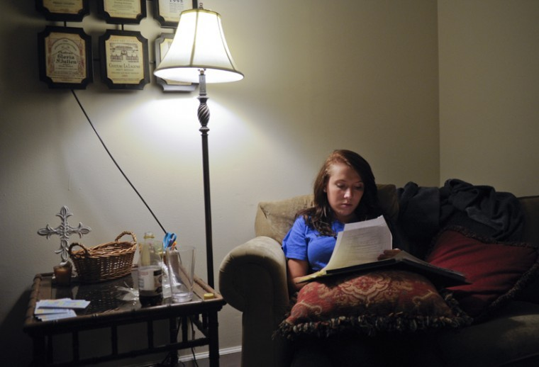 """Bowling Green sophomore Meg Jones does homework for a class on Wednesday night in her home. Jones often stays up late due to her inability to sleep. """"I'll look at my phone and see that it's three or five in the morning and I won't be tired,"""" Jones said."""