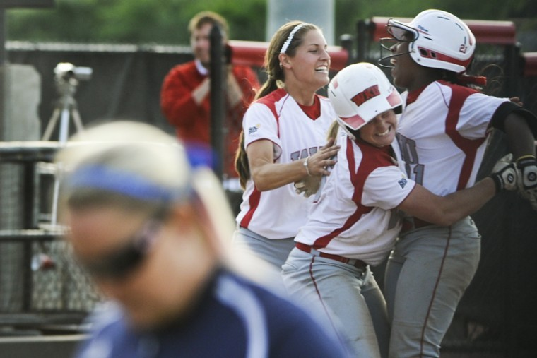 WKU+Lady+Toppers+celebrate+after+beating+FIU+7-6+in+the+final+inning+of+the+teams%27+second+game+Saturday+afternoon+at+the+WKU+Softball+Complex.%0A