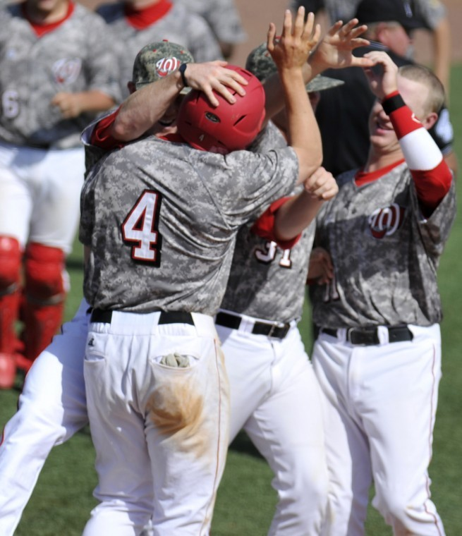 Senior+Outfielder+Jared+Andreoli+is+congratulated+after+scoring+the+winning+run+off+of+a+walk+in+the+bottom+of+the+eleventh+inning+Saturday+at+Nick+Denes+Field.+WKU+beat+Lousiana-Monroe+7-6.+JEFF+BROWN%2F+HERALD%0A