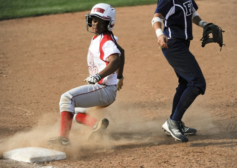 Junior Katrina Metoyer slides into third base during the second game of a doubleheader against FIU Saturday afternoon at the WKU Softball Complex. WKU won 7-6.