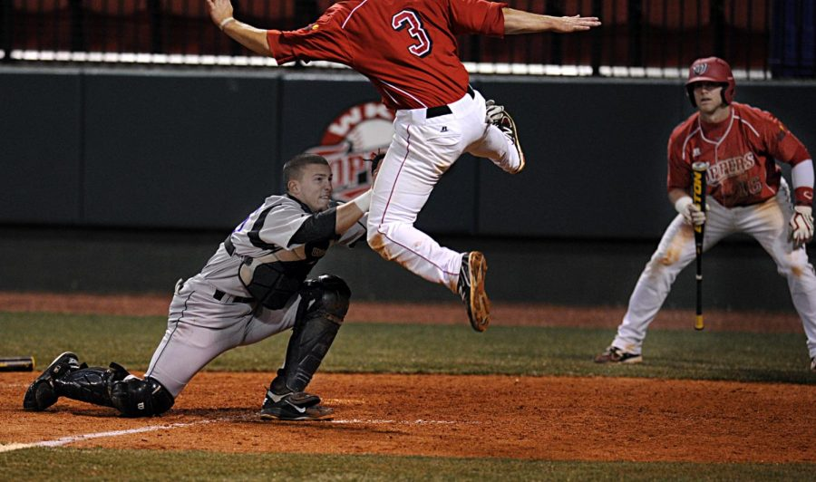 WKU second baseman Blake Crabtree is tagged out at home by Lipscomb catcher Taylor Stewart. WKU lost to Lipscomb on Nick Dennis Field 7-6 Tuesday evening.