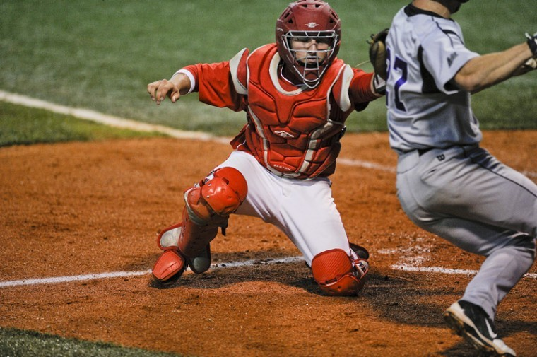 WKU+catcher+Devin+Kelly+attempts+to+tag+a+Lipscomb+runner+Tuesday+night+at+Nick+Denes+Field.+WKU+lost+to+Lipscomb+7-6+in+11+innings.%0A