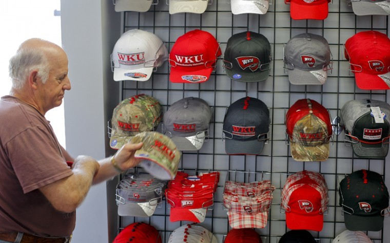 """Melvin Baldwin, a participant in Veterans Upward Bound at WKU, browses hats at the new WKU Store on Nashville Road. Baldwin, an Air Force veteran, is taking courses to learn how to use computers. """"When I graduated, we didn't have computers,"""" he said."""