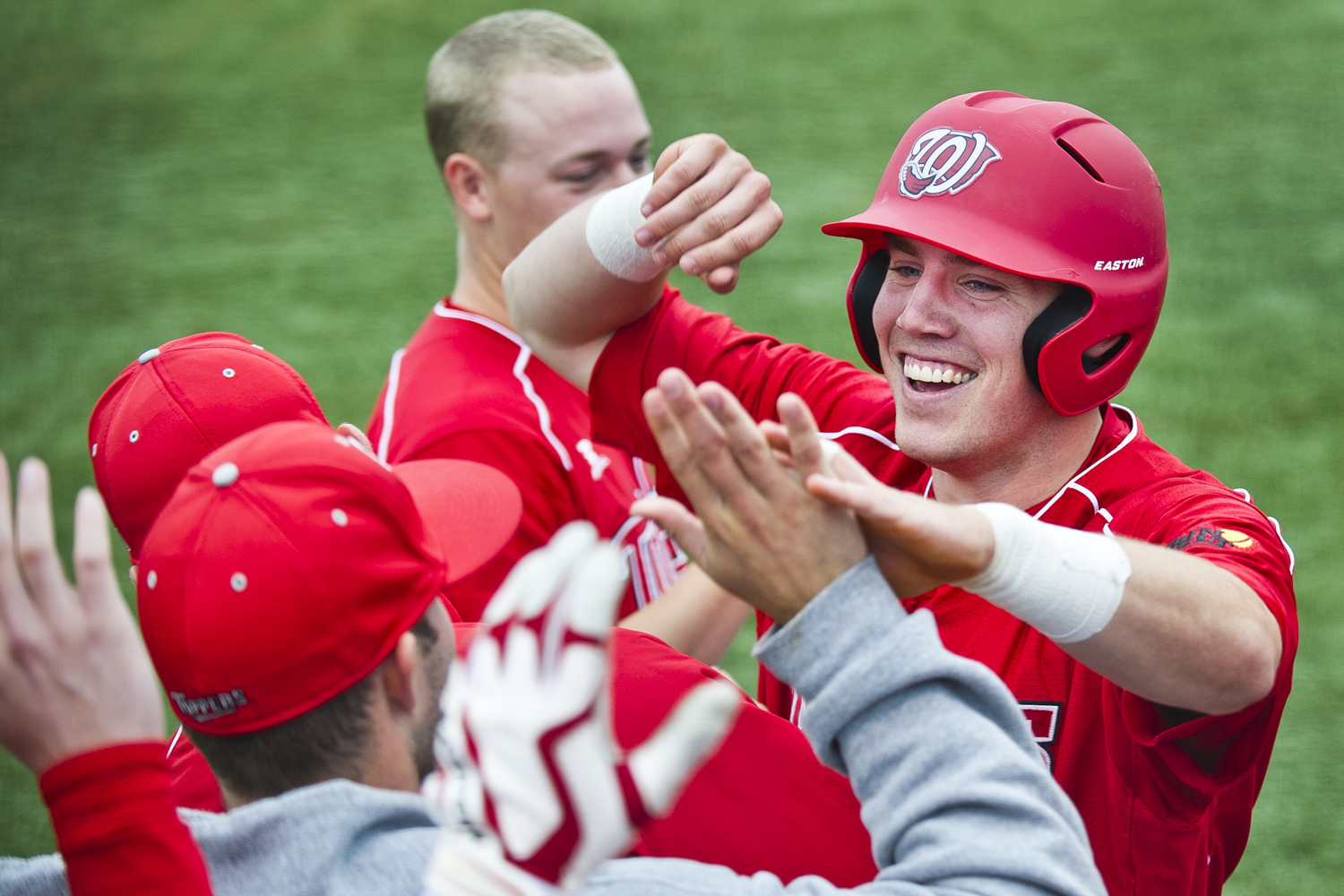 Junior+infielder+Adam+Lavelle+is+congratulated+by+his+teammates+after+scoring+a+run+against+Troy+at+Nick+Denes+Field+on+Saturday+afternoon%2C+April+21.+WKU+won+the+second+game+of+the+weekend+series+against+Troy+with+a+9-4+victory.%C2%A0%0A