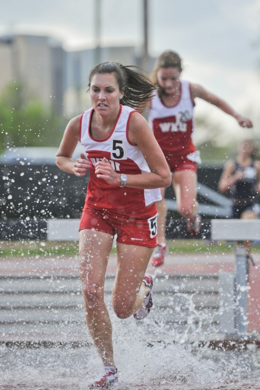 Brianne Porter makes her way through the water jump portion of the 2000-meter steeplechase during the Vanderbilt Black & Gold Invite March 25.