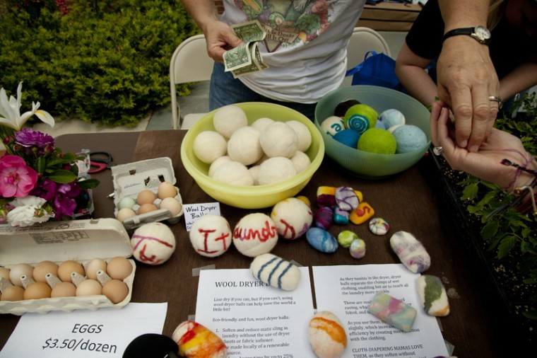 Joleen Stone, a member of the Bowling Green Community Farmers Market, sells wool dryer balls and wool soap during the Earth Day festival at Centennial Mall Friday. The wool dryer balls help reduce static electricity and soften clothes, and the wool on the soap acts like a scrubber to rid hands of dirt and grime.