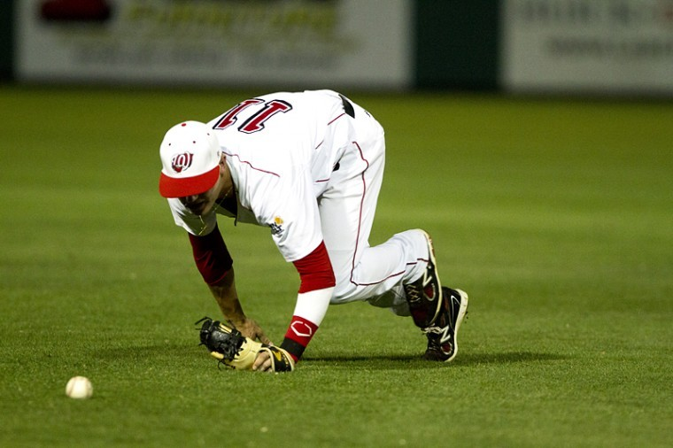 Infielder%2C+Scott+Wilcox%2C+trips+while+trying+to+catch+a+ball+hit+by+Graham+Odorn+of+University+of+South+Alabama+%28USA%29+during+the+top+of+the+second+inning.+The+Toppers+lost+to+USA+5-3.%0A