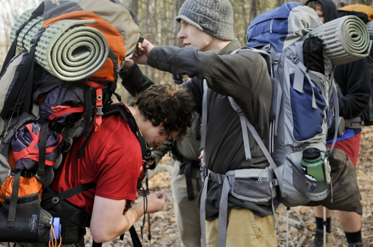 Frankfort senior Justin Hensley helps Elizabethtown junior Andrew Saults adjust his pack before getting back on the trail. While backpacking, it is essential to make adjustments to a pack so that it does not hurt. On average, the group was carrying around 40-50 pounds.