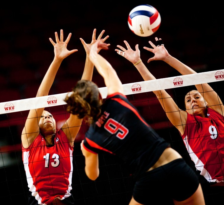 WKU%27s+Noelle+Langenkamp+and+Paige+Wessel+attempt+to+make+a+block+against+Austin+Peay%27s+Nikki+Doyle+Tuesday+night+in+Diddle+Arena.+The+volleyball+team+evened+their+record+with+a+3-0+defeat+of+the+Govs.%0A