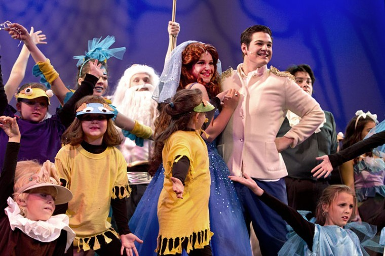 The cast of The Little Mermaid Jr. stands for applause at the end of Friday's production at Van Meter Hall. The play featured an all-youth cast and performed for area schools.