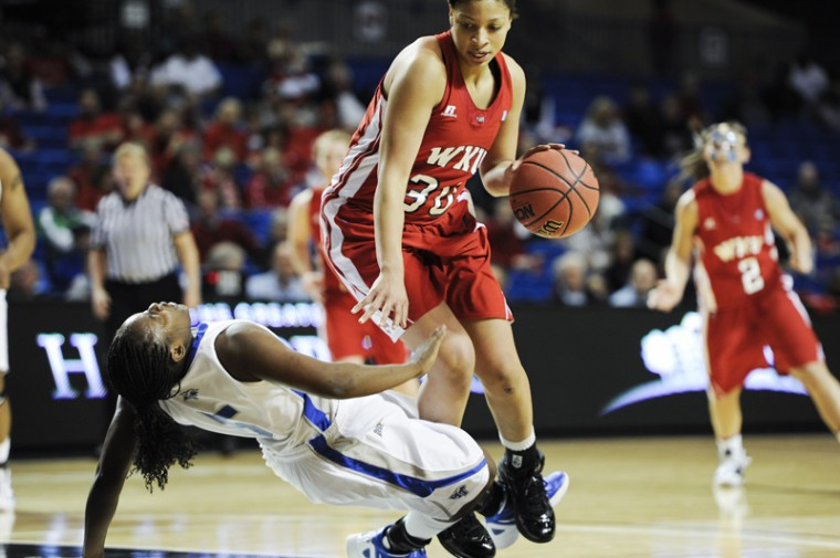 Freshmen forward Chastity Gooch knocks down a MTSU player during a lay up at the Sun Belt tournament against FIU on Sunday, March 4 in Hot Springs, Ark. Danay Fothergill lead WKU in points with a total of 18 points, still WKU lost, 65-57.