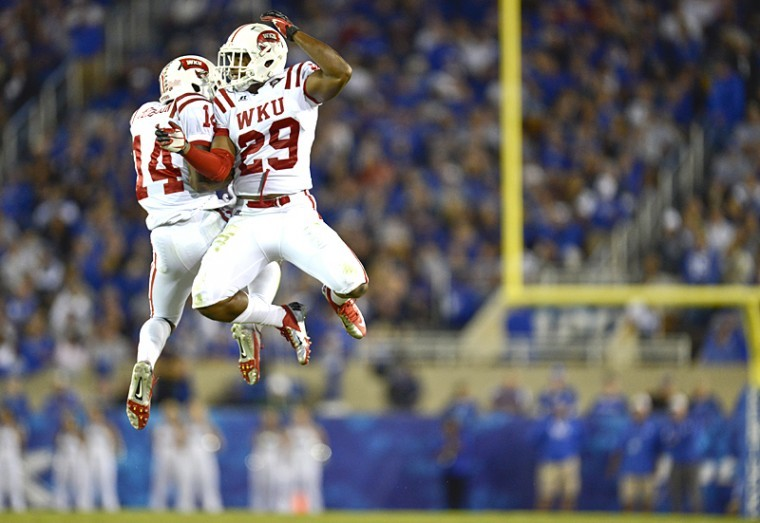 Toppers+defensive+back+Kareem+Peterson+%2814%29+and+defensive+back+Kiante+Young+%2829%29+celebrate+after+a+play+during+the+WKU-UK+football+game+in+Lexington+on+Saturday%2C+Sept.+15%2C+2012.%C2%A0%0A