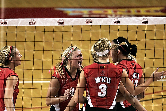 The+WKU+Lady+Toppers+Volleyball+team+celebrate+after+scoring+against+Lipscomb+University.+WKU+won+3-0+Monday+night+in+Diddle+Arena.%0A