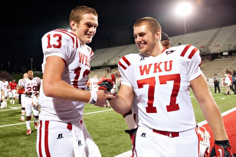 Western+Kentucky+quarterback+James+Mauro+%28left%29+celebrates+with+offensive+linesman+Forrest+Lamp+after+defeating+Arkansas+State+26-13+Saturday%2C+Sept.+29%2C+2012+at+Liberty+Bank+Stadium+in+Jonesboro%2C+Arkansas.+Mauro%2C+a+freshman%2C+threw+a+total+of+104+yards+to+score+two+touchdowns.+This+is+the+second+season+in+a+row+that+Western+Kentucky+has+begun+Sun+Belt+Conference+play+agains+the+Arkansas+State+Red+Wolves.+In+the+last+matchup%2C+The+Hilltoppers+lost+22-26.%0A