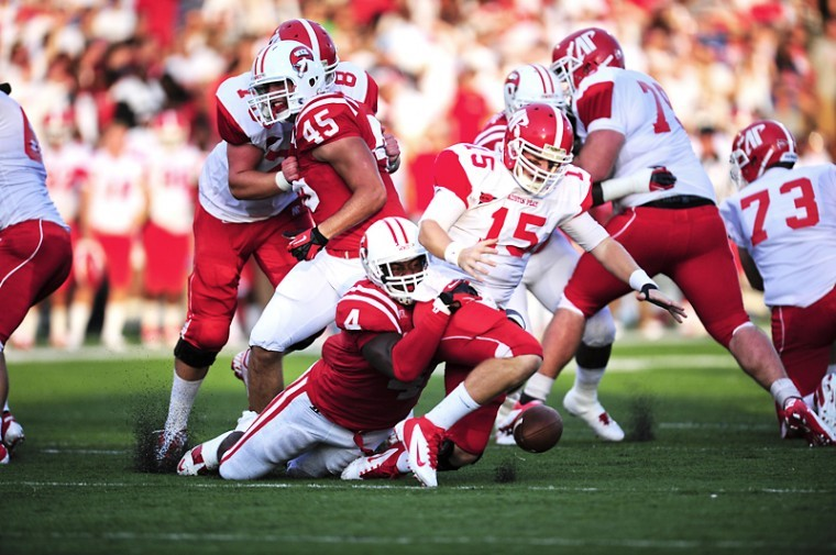 Austin Peay's senior quarter back Jake Ryaen fumbles and is tackled by WKU's junior line backer Andrew Jackson during the WKU's first home football game of the 2012 season against Austin Pay Governors at L.T. Smith Stadium. WKU won 49-10.