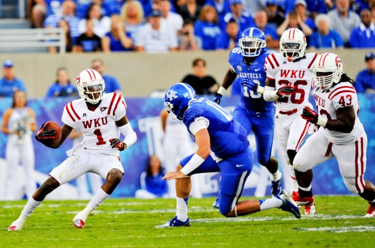 Sophomore+defensive+back+Jonathan+Dowling+intercepts+the+football+during+the+WKU+vs.+UK+game+at+Commonwealth+Stadium+September+15%2C+2012.+WKU+won+over+UK+in+overtime+32-31.%0A