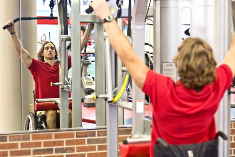 Glasgow senior Blake Perkins works out on Monday at the Preston Center. A motorcycle accident in 2011 left him paralyzed. Despite this, Perkins is still a personal trainer and continues to remain positive and workout.