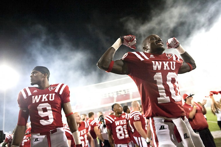 From+left%2C+WKU+senior+wide+receiver%C2%A0Marcus+Vasquez+and+sophomore+wide+receiver+Willie+McNeal+celebrate+their+victory+after+Saturday%27s+football+game+against+Austin+Peay.+WKU+won+the+game+with+a+final+score+of+49-10.%C2%A0%0A
