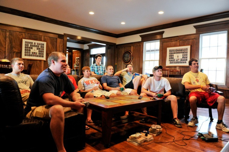 Members of the Sigma Chi house hang out together in the living room playing a game on the Nintendo 64 on a friday evening. Sigma Chi moved into their new house this fall.