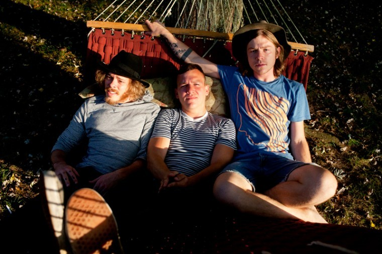 Left to right, Jared Champion, Brad Shultz and Matt Shultz, of Cage the Elephant, sit on a hammock at Champion's mother's house in Bowling Green last Friday. They had band practice at the house for 12 years and will be working on their upcoming album at a new band house in Portland, Tenn.