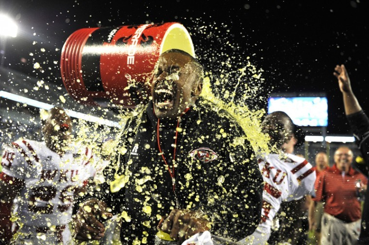 Head+coach+Willie+Taggart+is+doused+with+the+gatorade+bucket+after+WKUs+win+over+Kentucky.+WKU+won+32-31+against+Kentucky+at+Commonwealth+Stadium+on+Sep.+15%2C+2012.+This+is+WKUs+first+win+against+a+SEC+opponent.%0A