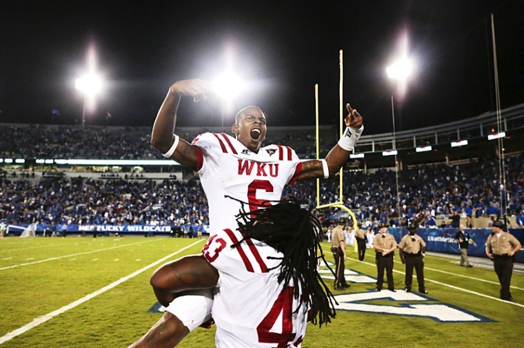 Toppers+quarterback+Kawaun+Jakes+%286%29+is+congratulated+by+his+teammate+%C2%A0defensive+lineman+Jamarcus+Allen+%2843%29+after+winning+the+game+after+the+WKU+vs.+Kentucky+Wildcats+football+game+in+Lexington+on+Saturday%2C+Sept.+15.+The+Toppers+won+in+overtime+32-31.%C2%A0%0A