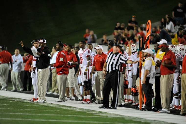 Senior+quarterback+Kawaun+Jakes+watches+on+the+sidelines+in+the+second+half+of+the+WKU+vs+Arkansas+State+game.+Jakes+did+not+return+to+the+game+after+a+knee+injury+in+the+first.%0A