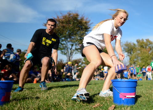 Louisville+freshman+Alexa+Wagoner%2C+of+Alpha+Omicron+Pi%2C+dashes+forward+to+complete+the+water+portion+of+the+Greek+Games.+Members+of+the+Greek+community+participated+in+the+games+Wednesday.%0A