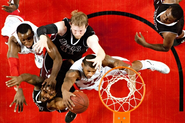 Western+Kentucky+guard+T.J.+Price+%28left%29+and+forward+George+Fant+fight+for+the+ball+against+Campbellsville+forward+Jordan+Myers+%28top%29+and+guard+Addison+Smith+during+the+game+Monday%2C+Oct.+29%2C+2012+at+Diddle+Arena+in+Bowling+Green%2C+Kentucky.+Western+Kentucky+defeated+Campbellsville+84-46.%0A