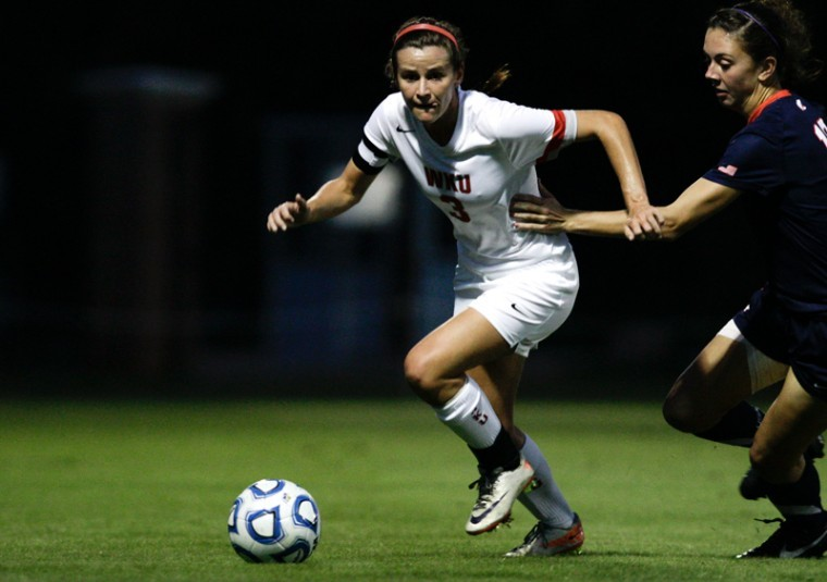 WKU plays Southern Alabama on Friday, Oct. 12 at the Western Kentucky Soccer Complex. The Lady Toppers won the game 2-0, with both goals scored in the first half by Sydney Sisler and Amanda Buechel. Lady Topper Senior is grabbed by a Southern Alabama player while breaking away with the ball.