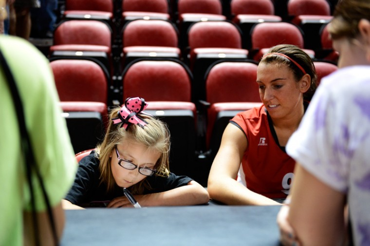 Harlie+Bryant%2C+age+6%2C+and+Paige+Wessel%2C+No.+9%2C+sign+shirts+and+posters+together+for+HopeForHarlie.org+after+WKU%27s+game+on+Saturday+in+Diddle+Arena.%0A