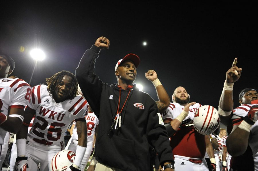 Head+coach+Willie+Taggart+and+the+WKU+football+team+sing+the+WKU+fight+song.+WKU+won+26-13+against+Arkansas+State+at+Liberty+Bank+Stadium+on+Sep.+29%2C+2012.%0A