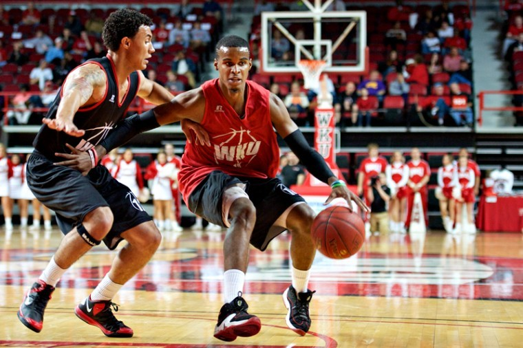 Senior+Jamal+Cook+drives+by+junior+Brandon+Harris+during+Hilltopper+Hysteria+on+Friday+in+Diddle+Arena.%0A