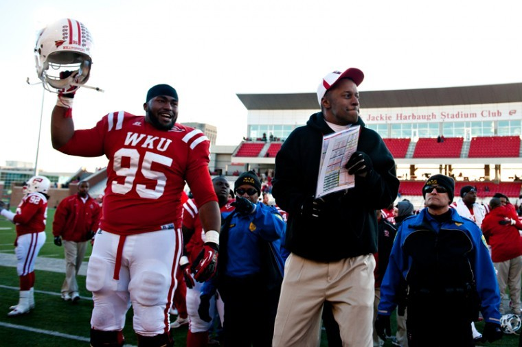 Head coach Willie Taggart celebrates with the players after defeating North Texas 25-24 Saturday, Nov. 24, 2012 at Houchens-Smith Stadium.