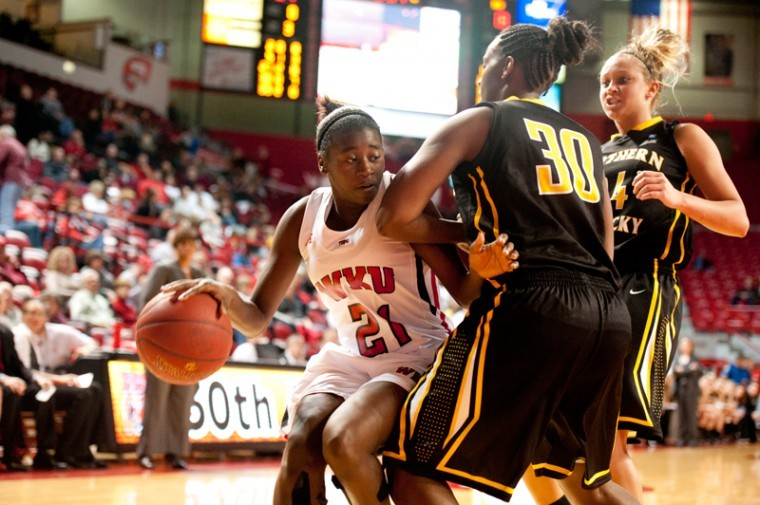 WKU+sophomore+guard+Alexis+Govan+runs+into+Northern+Kentucky+senior+forward+Tiara+Hopper+while+attempting+to+score+during+their+game+Saturday+night+at+EA+Diddle+Arena.%0A