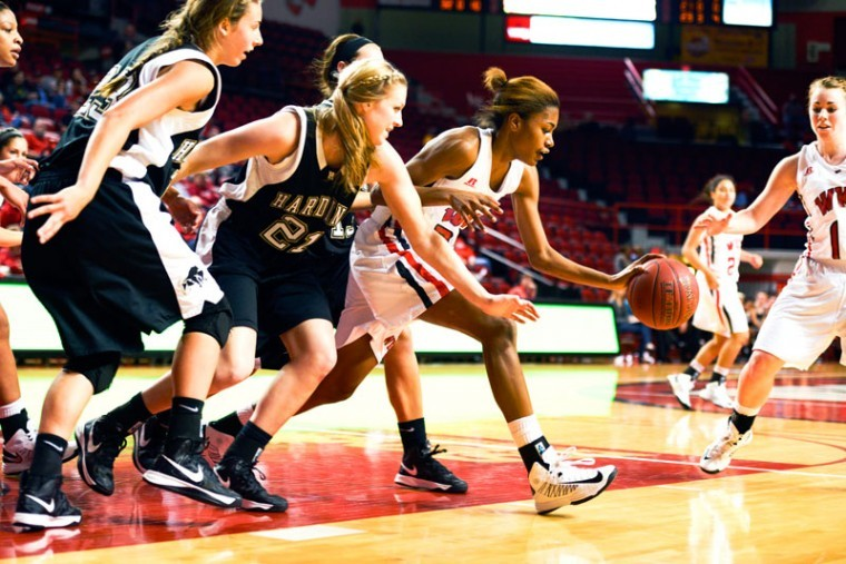 Freshman+Mariah+Sunkett+pushes+past+Hardin+players+to+retrieve+a+dropped+ball.+Sunkett+scored+10+points+during+the+game.%0A