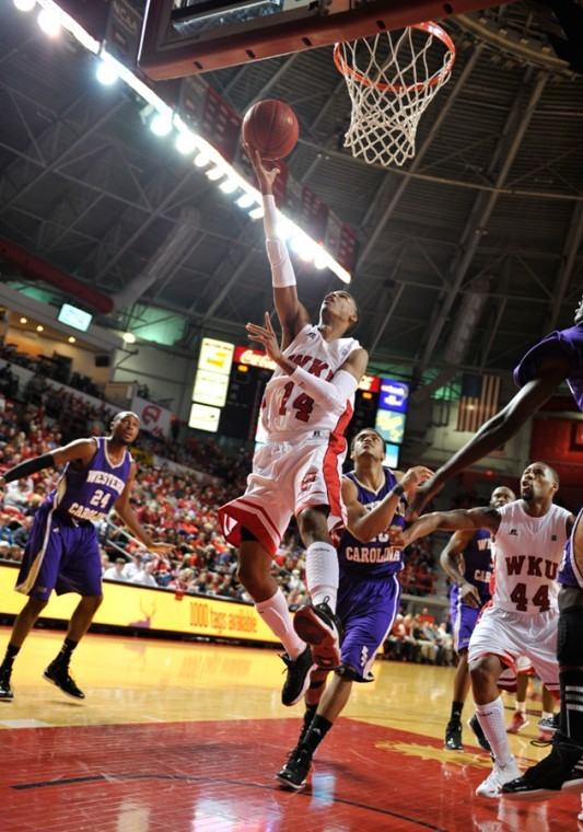 Senior+guard+Jamal+Crook+shoots+for+2+points+against+Western+Carolina.+Crook+scored+26+points+in+the+game.+WKU+won+92-81+against+WCU+on+Saturday+Nov.+17%2C+2012+at+Diddle+Arena.%0A