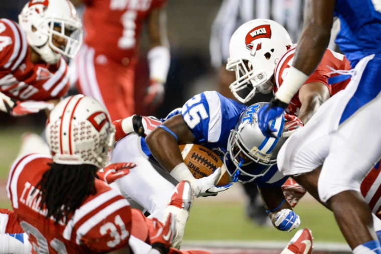 MTSU+running+back+Reggie+Whatley+%2825%29+is+tackled+by+the+WKU+defense+during+the+first+half%C2%A0of+WKU+vs.+MTSU+at%C2%A0Smith+Stadium+Nov.+1%2C+2012.%0A