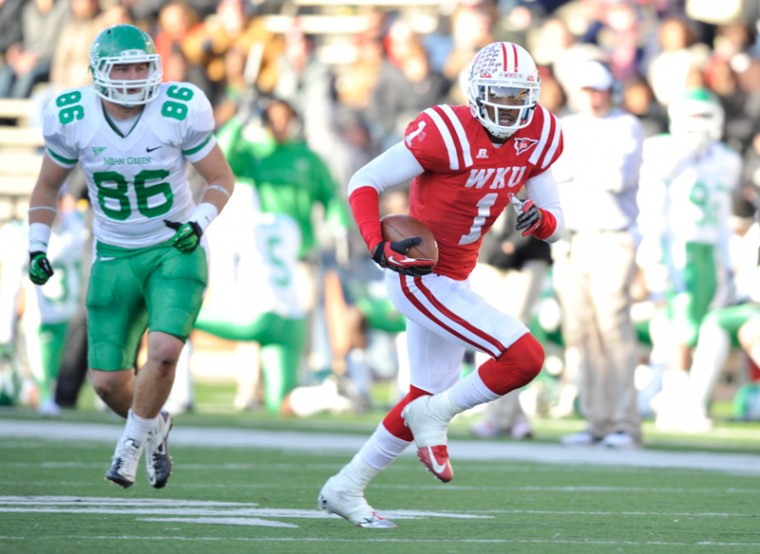 Sophomore+defense+back+Jonathan+Dowling+intercepts+a+football+and+returns+the+football+for+a+touchdown+in+the+4th+quarter.+WKU+won+25-24+against+North+Texas+on+Saturday+Nov.+24%2C+2012+at+Smith+Stadium.%0A
