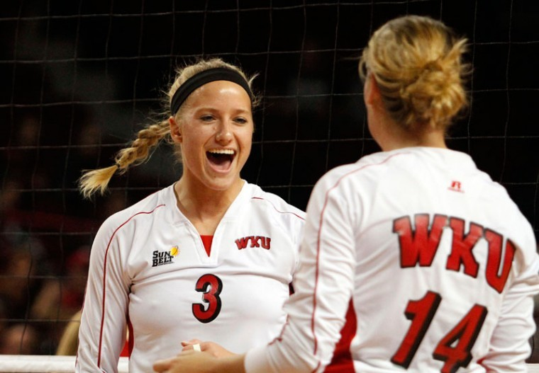 Sophomore%2C+middle+hitter%2C+Heather+Boyan%2C+celebrates+a+point+in+the+Sun+Belt+tournament+with+Junior%2C+setter%2C+Melanie+Stutsman.+The+tops+won+in+three+straight+sets+to+advance+to+the+finals.%0A