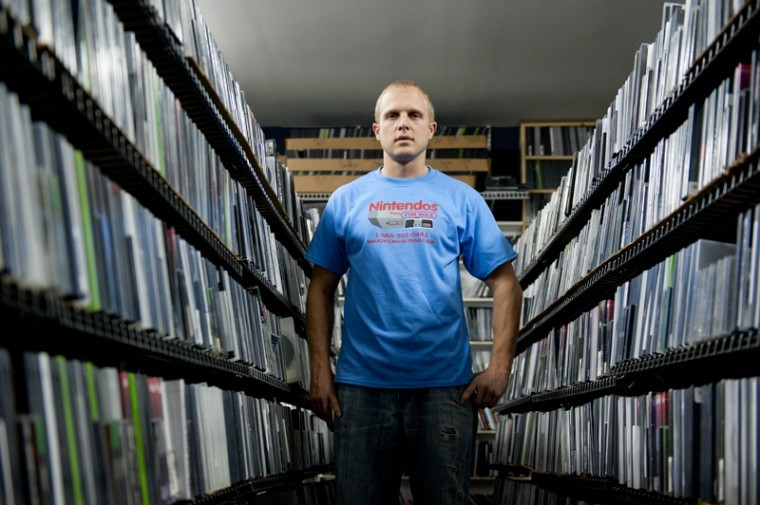 WKU alumnus Daniel Moore, of Kansas City, Mo., stands among his video game collection in the basement of his store, NintendosForSale. Moore has been selling vintage video games and systems since 2007. IAN