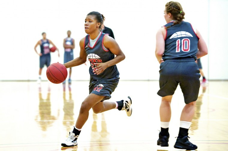 Junior guard Bianca McGee, left, runs past sophomore guard Danay Fothergill to shoot the ball during the first practice of the season Monday, Oct. 1, 2012 at the practice gymnasium inside E.A. Diddle Arena.