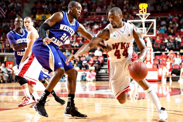 Sophomore forward George Fant (right) drives the ball past WCU junior guard Brandon Boggs during the game Saturday, Nov. 17, 2012 at Diddle Arena. Western Kentucky defeated Western Carolina 92-81.