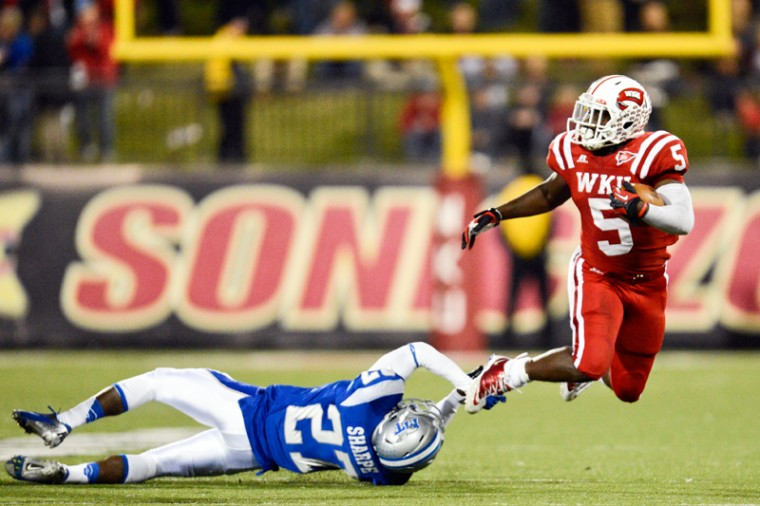 WKU%C2%A0running+back+Antonio+Andrews+%285%29+is+knocked+into+the+air+while+running+the+ball+against%C2%A0MTSU+Blue+Raiders+at+Smith+Stadium+on+Nov.+1%2C+2012.%0A