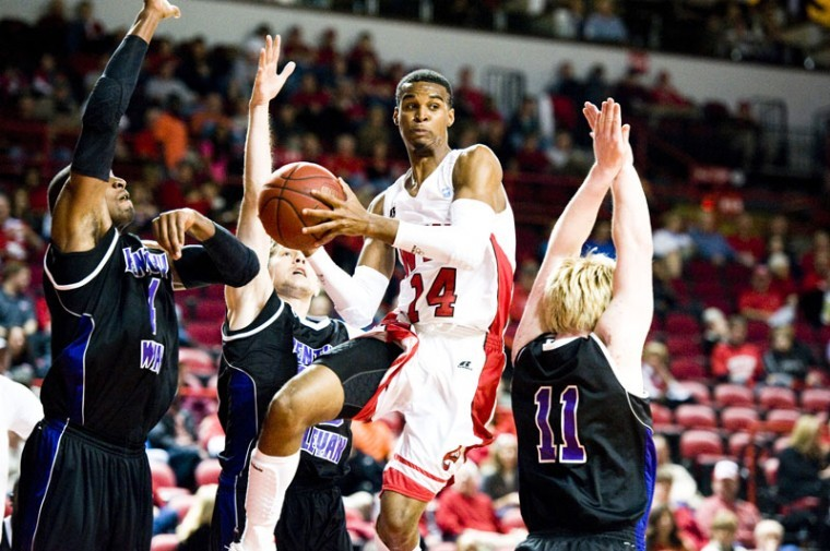WKU+point+guard+Jamal+Crook+looks+to+pass+the+ball+while+driving+through+Kentucky+Wesleyan+center+Doninique+Dawson%2C+guard+Luke+Shelley%2C+and+guard+Lucas+Baker.%0A