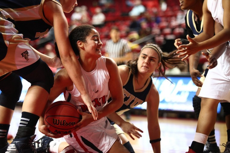 Sophomore+guard+Ileana+Johnson+fights+for+the+ball+against+FIU+players.+Johnson+contributed+6+total+points+to+WKU%27s+62-56+win+over+FIU.%0A