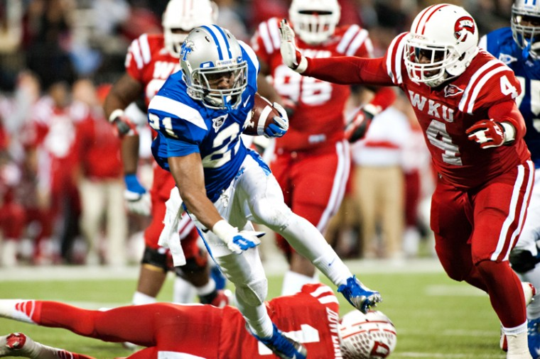 MTSU%C2%A0running+back+Drayton+Calhoun+%28top%29+is+brought+down+by%C2%A0WKU+defensive+back+Jonathan+Dowling+during+the+game+on%C2%A0Nov.+1%2C+2012+at+Smith+Stadium.+The+game+was+tied+17-17+at+halftime.%0A