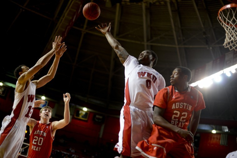 Junior+forward+Kene+Anyigbo+reaches+for+a+rebound+ball+on+Tuesday+night+during+the+game+against+Austin+Peay.+WKU+won+74-54+against+Austin+Peay+at+Diddle+Arena.%0A